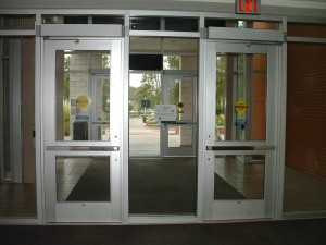 Interior entry doors for the library. There are 2 doors separated by a 3 foot pane of glass.