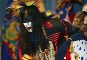 Indian custom performs a story in dance on stage during the Native American Indian Heritage Celebration in Alexander Hall, at Fort Gordon, Georgia (GA),