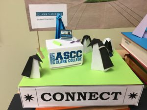 "origami penguins gather around an ASCC welcome desk near a sign reading ""Connect"""
