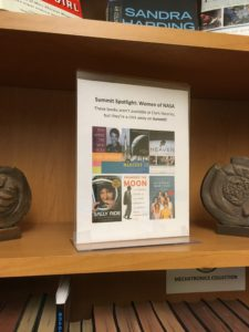 A collection of books about women at NASA available on Summit.